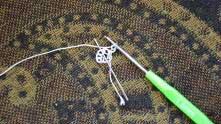 1 ряд. Набрали 2 в.п. В центр колечка связать 17 столбиков без накида (СБН).