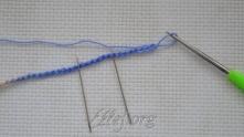 Рапорт = 9. Число в.п. на наборной цепочке кратно 9 + 5 петель. Начиная с 8-ой петли от крючка свяжите 7 столбиков с накидом (ССН).
