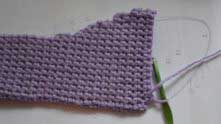 Approaching the moment where the decreases start. Decreases may be worked by just skipping the last stitch in the row.