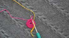 Yarn over. Insert hook in 15th dc and trough pink loop.