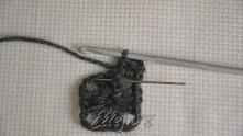 На фото: связали 2 полустолбика. Под ССН, где иголка, связать лицевой рельефный столбик с накидом...