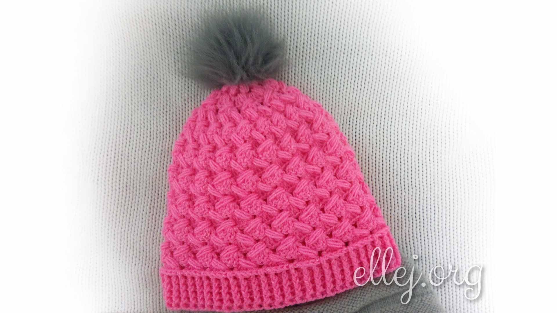 Розовая шапка с пышными зиг-загами